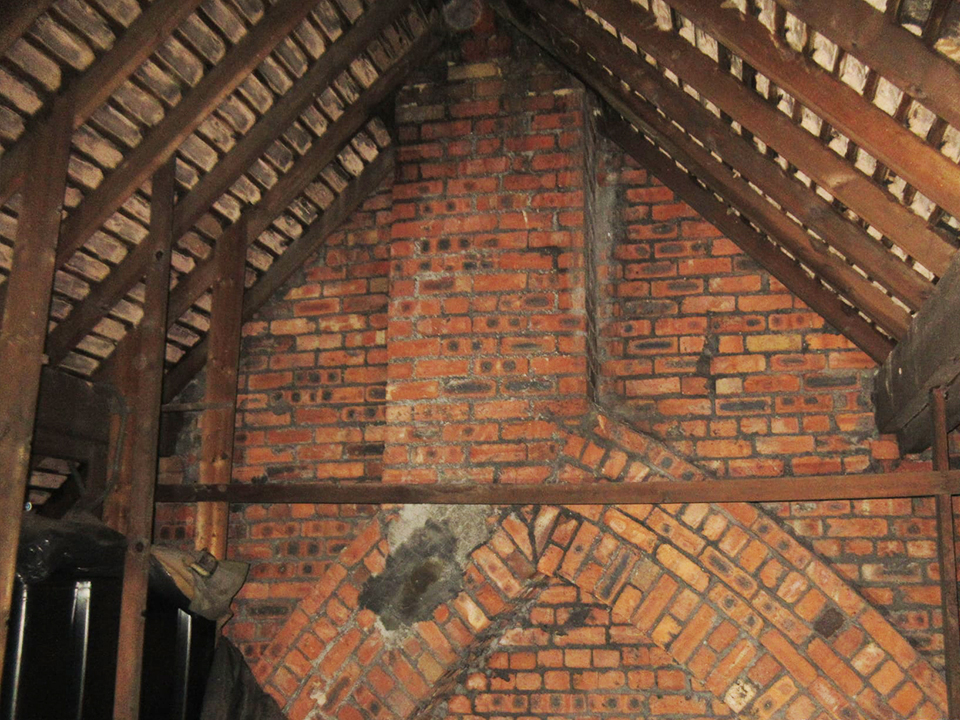 roof mortar torching visible in large loft space of house